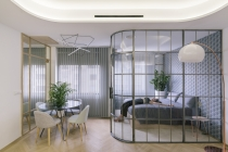 Glass Walls and Lots of Curves Distinguish Luxury  Apartment Renovation